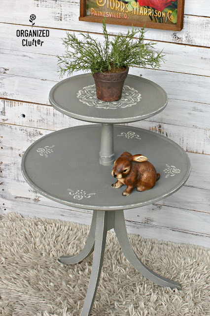 Photo of a two tiered round table with mandala stencils