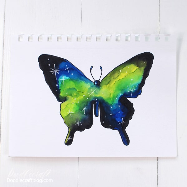 Paint a watercolor butterfly silhouette like a stunning galaxy with Tombow