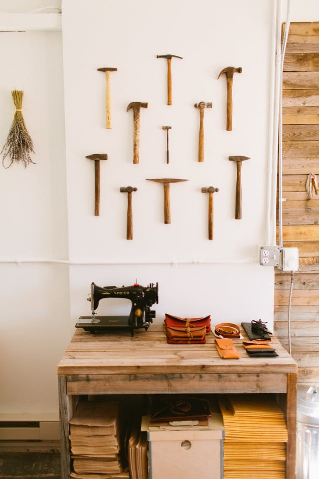 Gallery wall of old hammers from Stitch & Hammer #gallerywall #decorating #decoratingideas #andersonandgrant