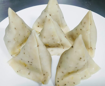Filled and sealed Samosa pastry for Samosa recipe