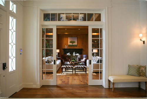 Entrance with interior transom to walnut paneled library