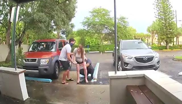 Камера наблюдения сняла, как девушка стоя рожает на парковке, не добежав до дверей роддома