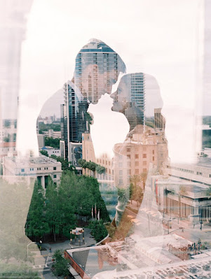 bride and groom with city skyline
