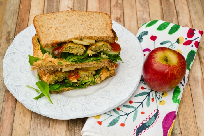 A delicious vegan sandwich. Sweet crunchy apple with lightly spiced falafel, creamy hummus and fresh salad on soft brown bread with a sweet bit of heat from some mango chutney. Plus 15 family sandwich ideas.