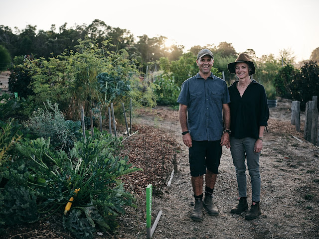 Photo of Cree Monaghan and Tim Hall on in the farm surrounded by foliage