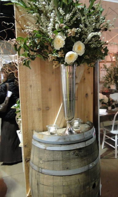 ceremony flowers with wine barrel