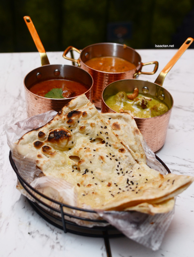 Frangipaani's Butter Chicken, Lamb Rogan Josh and Malai Kofta, taken with butter naan