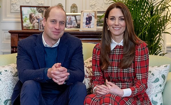Kate Middleton wore red tartan pleated midi dress by Emilia Wickstead and pearl earrings from Simone Rocha