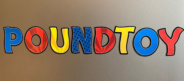 POUNDTOY written in magnetic letters on a fridge