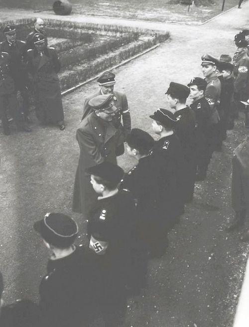 Hitler Axmann Fegelein 20 March 1945 worldwartwo.filminspector.com