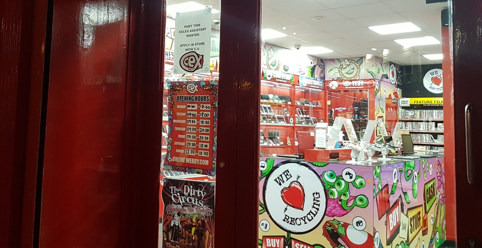 on a window with CEX galway games exchange winter opening hours and a we love recycling sticker with a bright red heart