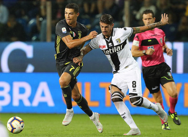 Cristiano Ronaldo of Juventus competes for the ball with Alessandro Deiola of Parma Calcio during the serie A match between Parma Calcio and Juventus at Stadio Ennio Tardini on September 1, 2018 in Parma, Italy. (Aug. 31, 2018 - Source: Marco Luzzani/Getty Images Europe)