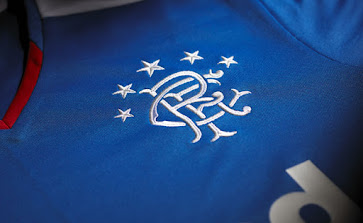 75cac7f4fa9 ... Rangers Kit introduces a modern blue   red v-neck collar