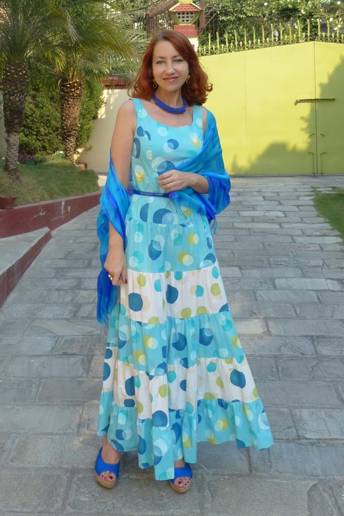 Large polka dot maxi dress worn with silk scarf