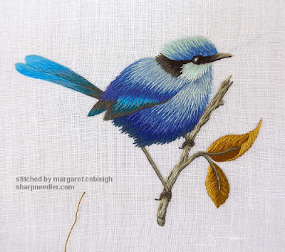 Thread painted blue bird nearly complete