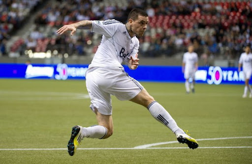 Vancouver Whitecaps striker Eric Hassli watches his volley hit the back of the Toronto net