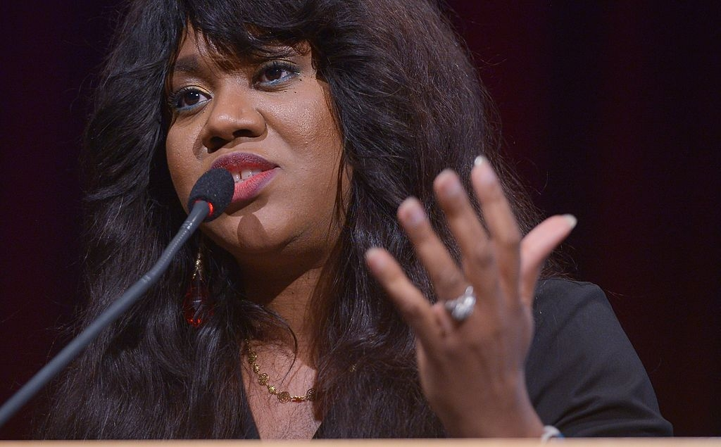 """Stella Damasus, Nigerian actor and film producer, speaks at an event launching the gender-based sexual violence exhibition """"Wounded to Death"""" in the World Bank Headquarters' Preston Auditorium on May 22, 2014 in Washington, DC. AFP PHOTO/Mandel NGAN (Photo credit should read MANDEL NGAN/AFP via Getty Images)"""