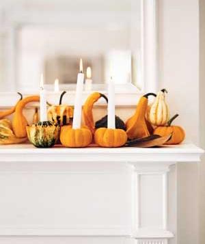 These candles in mini pumpkins are a fun autumn decor idea.