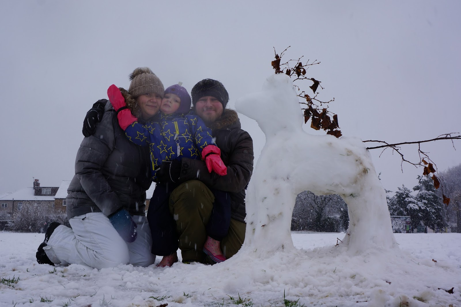 family photograph playing in snow