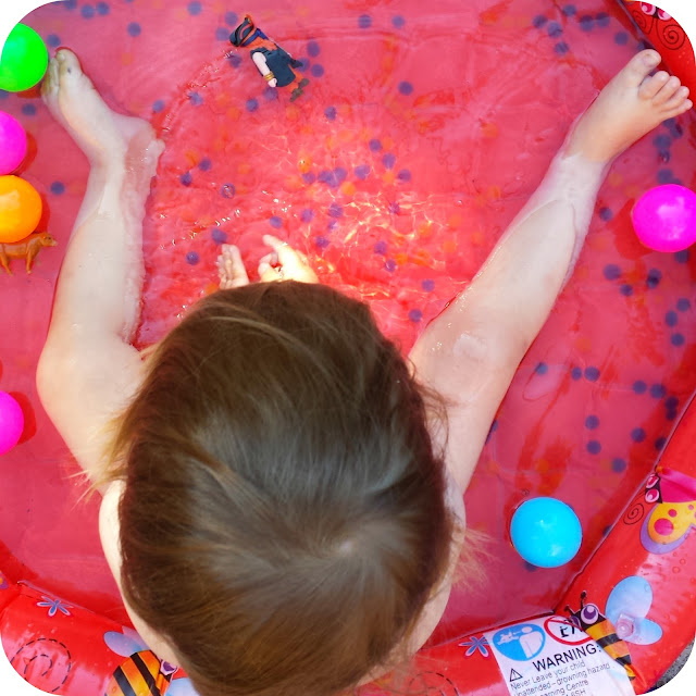 paddling pool, water bead play, garden in summer play