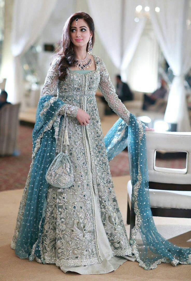45f97063444 ... charm with a jhoomar kind of a look from mughal era a floor length  anarkali with a huge middle slit paired with a lehenga looks gorgeous and  elegant.