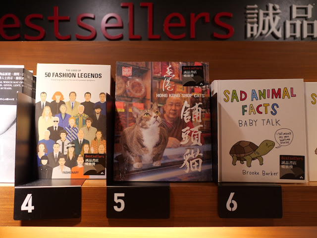 """The Lives of 50 Fashion Legends"" and ""Hong Kong Shop Cats"" on a Top 10 Bestsellers shelf"