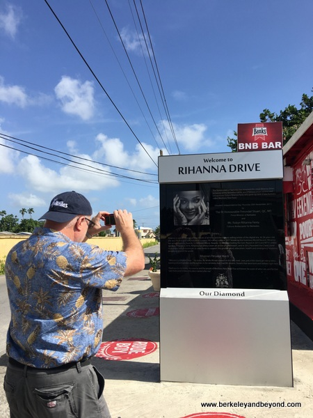 fan at dedication sign for Rihanna's childhood home in Bridgetown, Barbados