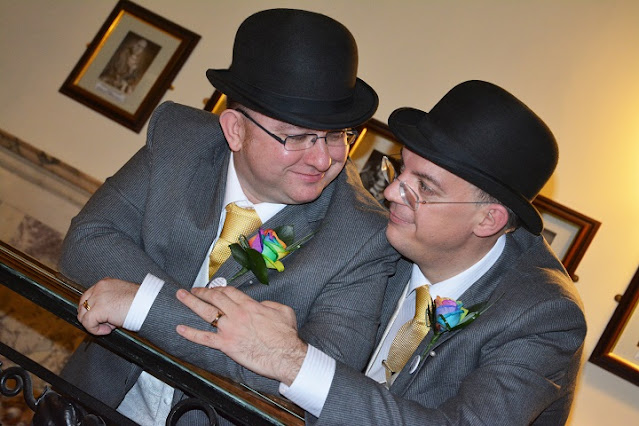 Richard and I at Stockport Town Hall, in our wedding bowlers and rainbow buttonholes at our wedding