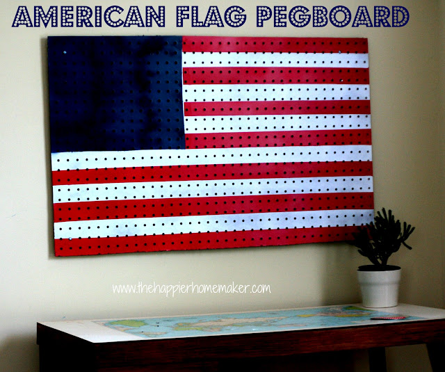 A close up of an American flag pegboard over a desk with a small plant