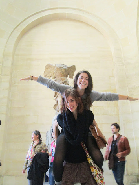 Having fun infront of Nike of Samothrace in the Lourve.