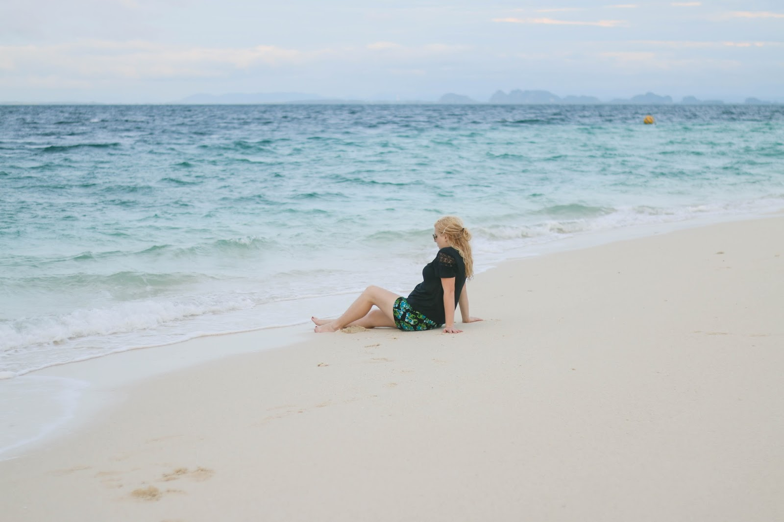 Fashion and Travel Blogger (Global Fashion Gal) wearing tropical shorts at Poda Island, Thailand.