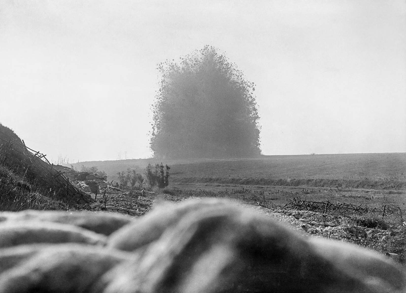 A 45,000-pound mine (2 ton) under the German front line positions at Hawthorn Redoubt is fired 10 minutes before the assault at Beaumont Hamel on the first day of the Battle of the Somme. The mine left a crater 130 feet (40 m) across and 58 feet (18 m) deep.