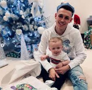 Phil Foden With His Son