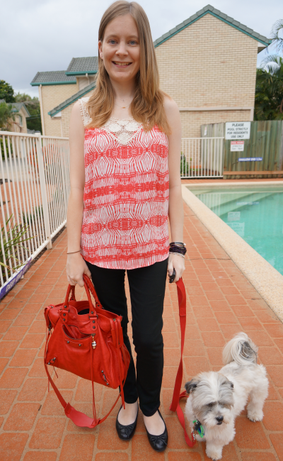 black skinny pants printed tank for the office red balenciaga bag