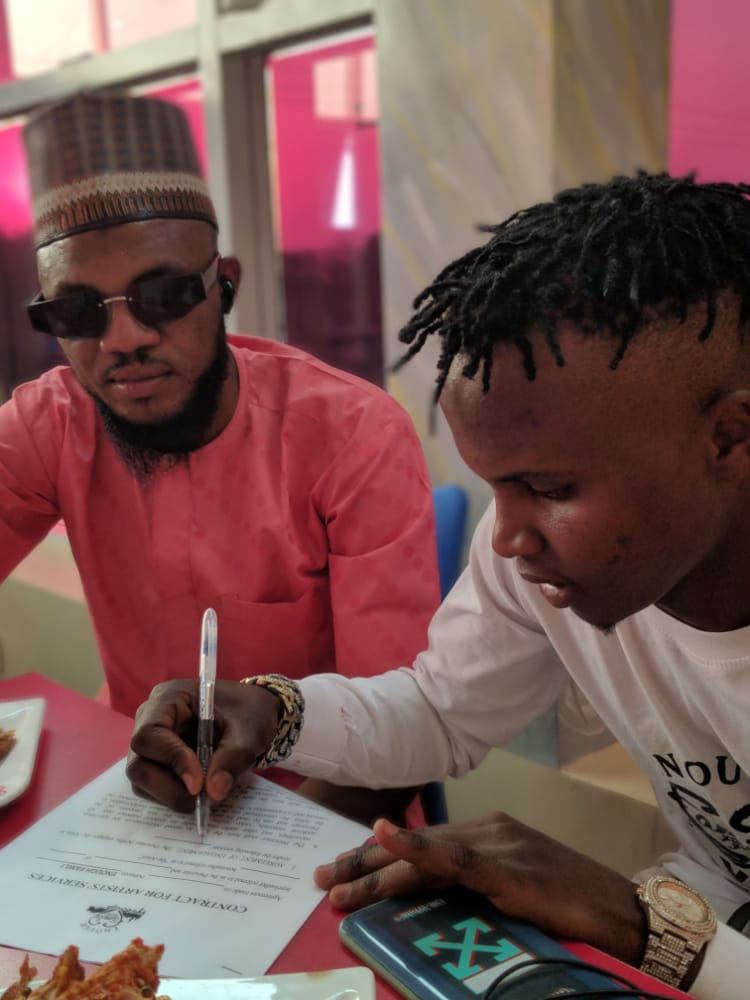 [Photos] Arewa Artist 'Flykeed' gets signed to 'Enough Family Entertainment] #Arewapublisize