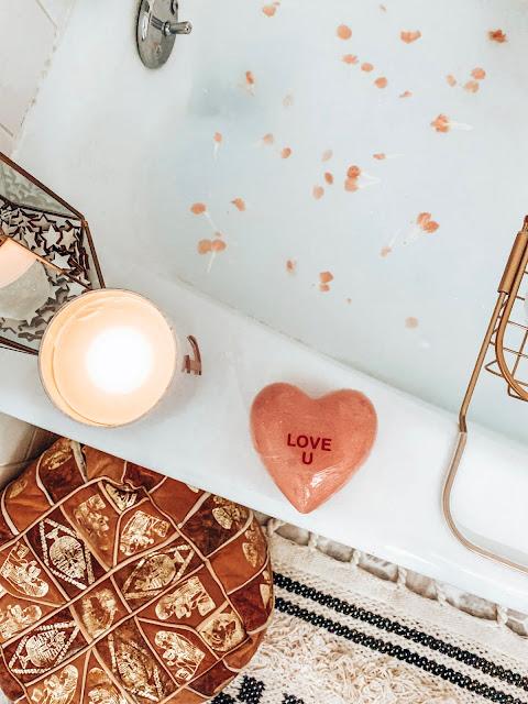 Bathtub with leather ottoman and bath caddy