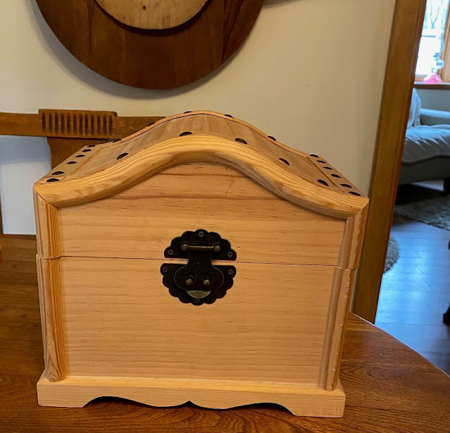 Photo of small unpainted wooden treasure chest