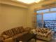 phòng khách có bancong tại khu chung cư Flemintong