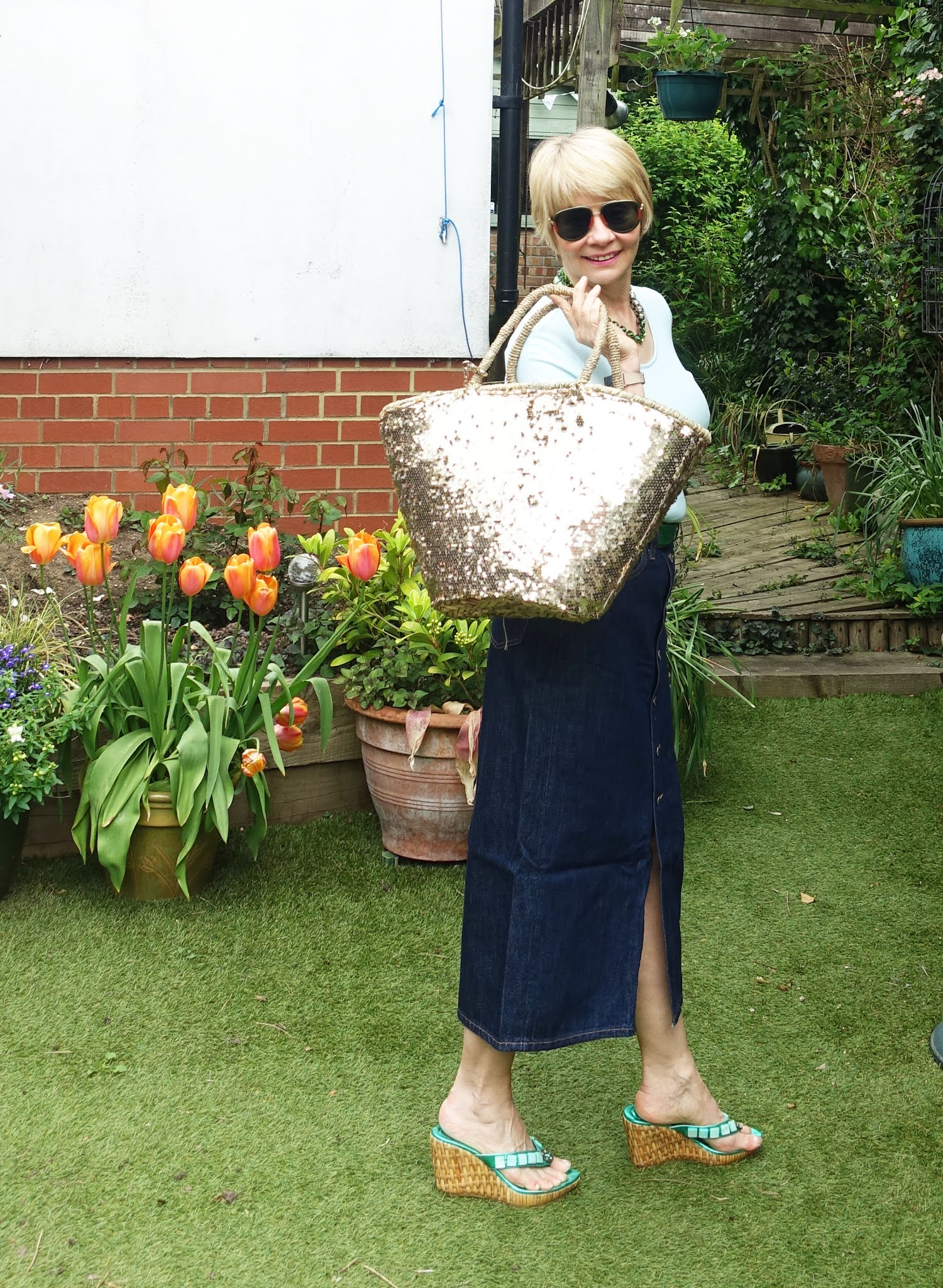 A gold sequin beach bag and Is This Mutton's Gail Hanlon is ready to go to the beach