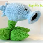 http://www.ravelry.com/patterns/library/plants-vs-zombies-snow-pea-shooter
