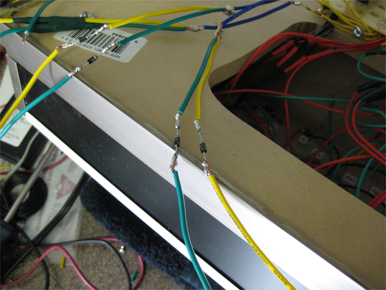 Diodes installed in two power leads for switch machine overload indicator LED lights