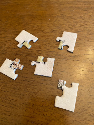 Photo of five corner pieces. Puzzles only have four corners.