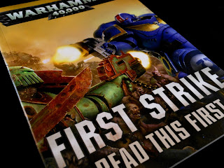 "The ""Read This First"" book from Warhammer 40,000: First Strike."