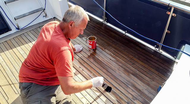 Photo of applying the deck sealant