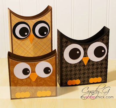 Three different sized boxes made to look like a primitive owl.