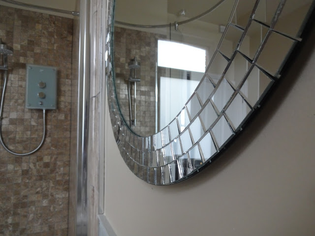 mosaic mirror in bathroom