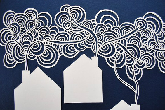 paper cut houses with swirling chimney smoke
