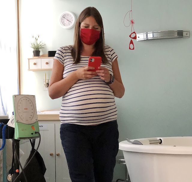 Fiona wearing a mask in the birth centre