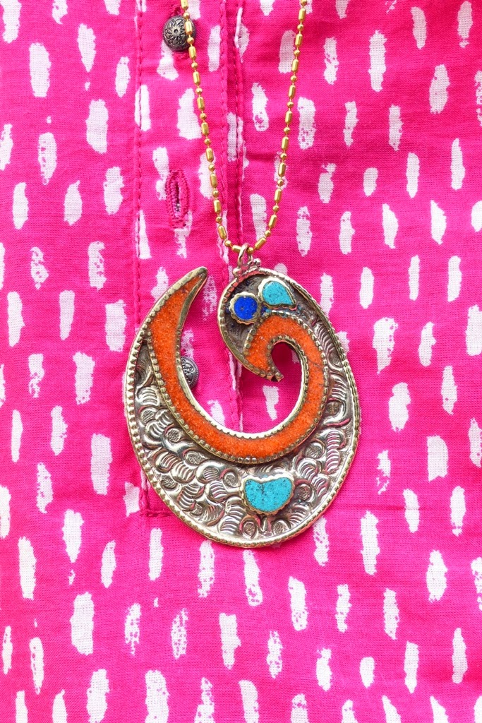 Stylized bird pendant decorated with turquoise, coral and lapis lazuli