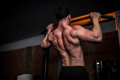 Wide grip pull-ups on the bar